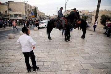 Mounted Israeli police is seen deployed outside Jerusalem's Old City's Damascus Gate, following an incident inside Jerusalem's Old City