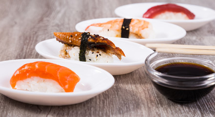 four kinds Nigirisushi on saucers