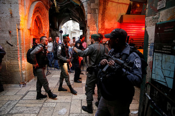 Israeli security forces stand near the site where an Israeli was wounded in a stabbing attack in Jerusalem's Old City, Israeli Police said