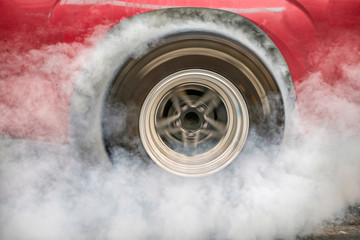 Poster Motorise Drag racing car burns rubber off its tires in preparation for the race