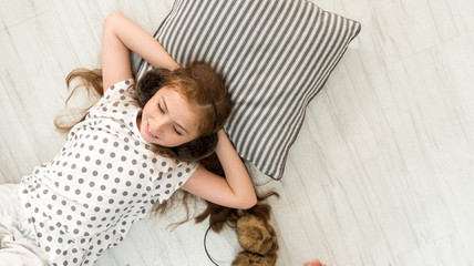top view of happiness caucasian girl kid smile have fun and Girls are lying down to listening the music