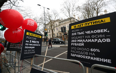 Anti-Putin placards are displayed outside the Russian Embassy in London