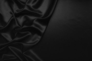 black abstract background luxury cloth or liquid wave or wavy folds of grunge silk texture satin velvet material or luxurious Christmas background or elegant wallpaper design, background