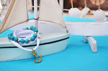 summer jewelry - agate gemstone bracelet - gold anchor bracelet - turquoise background