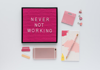 Colorful Agenda, Office Accessories, Mobile Phone, and Pink Letter Board Quote on White Background