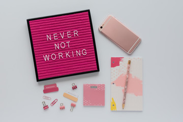 Agenda, Office Accessories, Mobile Phone and Pink Letter Board Quote on White Desk Top