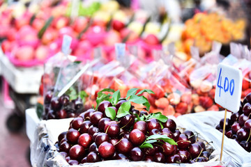 Cherries and other fruits on the street market stall