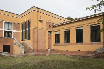 External facade of old and abandoned devastated school, ready for renovation