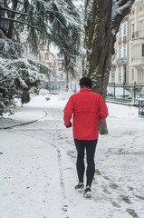 Mulhouse - France - 18 March 2018 - man running in the snow in public park