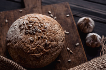 bread with seeds on a brown board