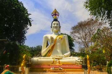 Large gold Buddha statue located outdoors.