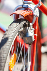 Close-up of a Bicycle Dynamo on a red Retro Bike, View from the Front