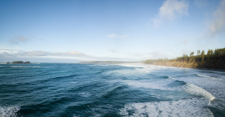Aerial panoramic seascape view during a vibrant winter morning. Taken near Tofino and Ucluelet, Vancouver Island, British Columbia, Canada.