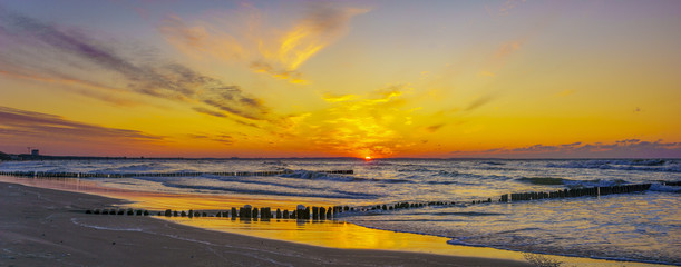 A beautiful sunset over the sandy beach on the Wolin Island in Poland in the winter