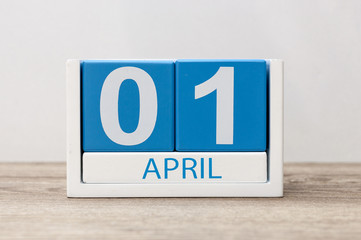April 1st. Day 1 of april month, calendar on light background. Spring time, Easter and Fools day