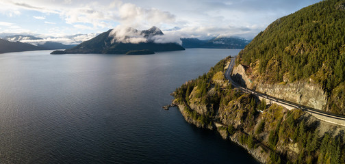 Aerial panoramic view of the Sea to Sky Highway in Howe Sound during a vibrant sunny day. Taken North of Vancouver, British Columbia, Canada.