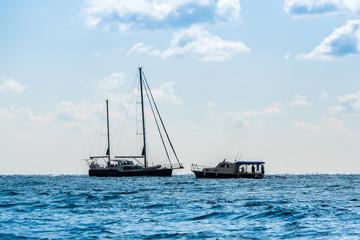 the rocky shore and sailboat at sea. Fiolent, Crimea