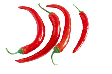 four long red chili peppers