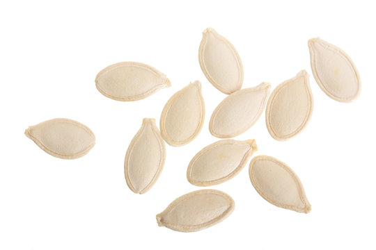 Heap of pumpkin seeds isolated on white background. Top view. Flat lay