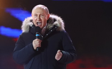 Russian President and Presidential candidate Putin delivers a speech during a rally and concert marking the fourth anniversary of Russia's annexation of the Crimea region, in central Moscow