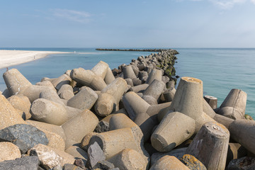Breakwater of tetrapots protecting harbor and beach of Helgoland island in German North sea