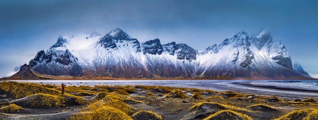 Vestrahorn mountain range and Stokksnes beach panorama, near Hofn, Iceland. An unidentifiable...