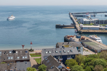 Aerial view harbor and houses of village at German island Helgoland