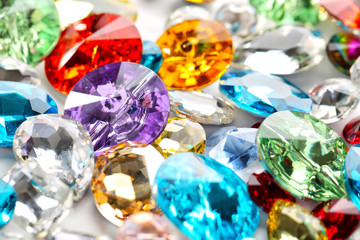 Colorful precious stones for jewellery on table Wall mural