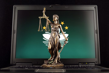 Symbol of law and justice with Macau Flag on laptop. Studio shot.