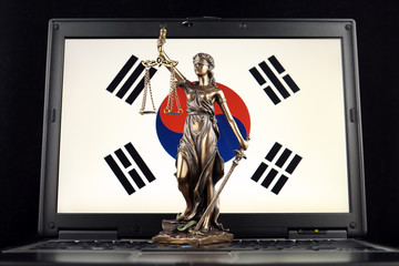 Symbol of law and justice with South Korea Flag on laptop. Studio shot.