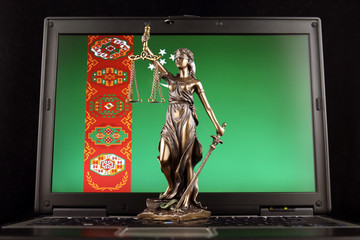 Symbol of law and justice with Turkmenistan Flag on laptop. Studio shot.