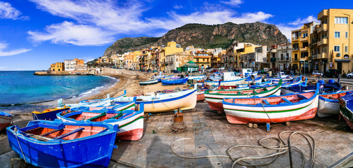Traditional fishing village Aspra with colorful boats in Sicily. Italy Fototapete