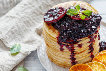 Stack of pancakes with berry sauce.