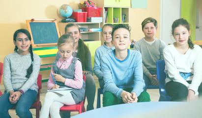 Nice boys and girls  listening teacher