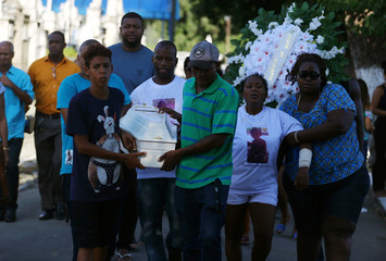 Relatives of 1-year-old Benjamin mourn during his funeral in Rio de Janeiro