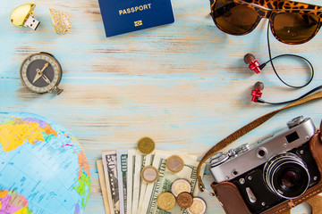 Tour accessories conceptual image of planing trip on blue wooden background