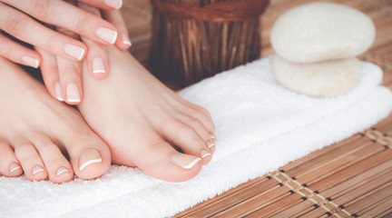 Fotorolgordijn Pedicure Care for beautiful woman legs on a towel