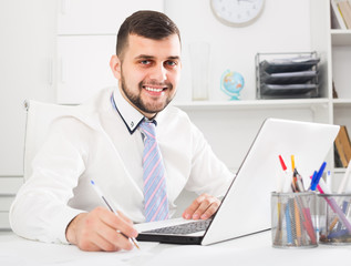 Male employee is having productive day at work