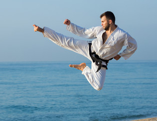 young man practicing karate positions