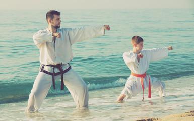 Man and boy practising karate