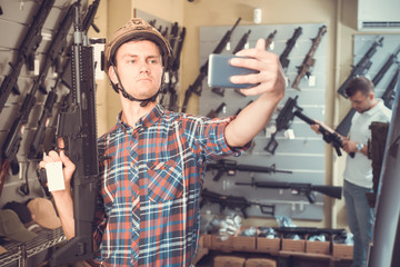 Man taking selfie with weapon