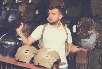 Man choosing helmet