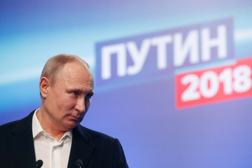 Russian President and Presidential candidate Vladimir Putin delivers a speech at his election headquarters in Moscow