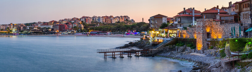 Seaside landscape, panorama, banner - view of the embankment with fortress wall during sunset in the city of Sozopol on the Black Sea coast in Bulgaria. Wall mural
