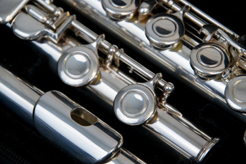 Close up of the silver plated musical instrument flute