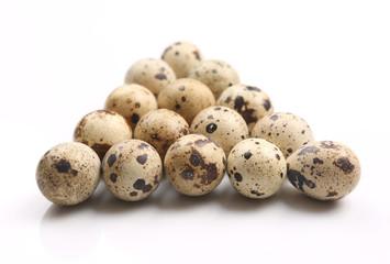 quail eggs on white background.
