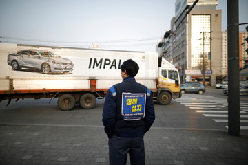Hwang Ho-in, a forklift truck driver at GM's Bupyeong plant stands outside the plant in Incheon