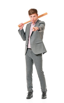 Anger man in suit with wooden baseball bat. Guy standing and pointing at camera choosing you - full length portrait, isolated on white background.
