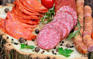 Sliced of chorizo, salami, sausages with herbs