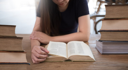 beautiful girl happy to sit reading a book Close-up of female relaxing in coffee shop cup of tea